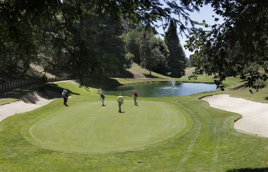 Members play the sixteenth hole at Seqouyah Country Club on Wed. June 12, 2013 in Oakland, Calif. Sequoyah Country Club high in the Oakland hills is celebrating its one hundred year anniversary. The club founded in 1913 was the site of the old western open golf tournament.