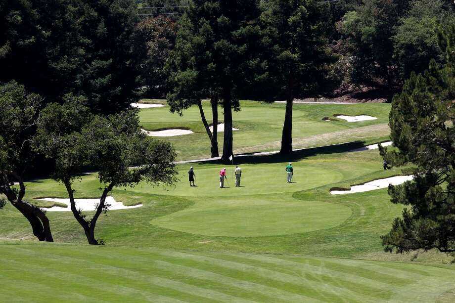 Members play the eleventh hole at the Sequoyah Country Club on Wed. June 12, 2013 in Oakland, Calif. Sequoyah Country Club high in the Oakland hills is celebrating its one hundred year anniversary. The club founded in 1913 was the site of the old western open golf tournament.