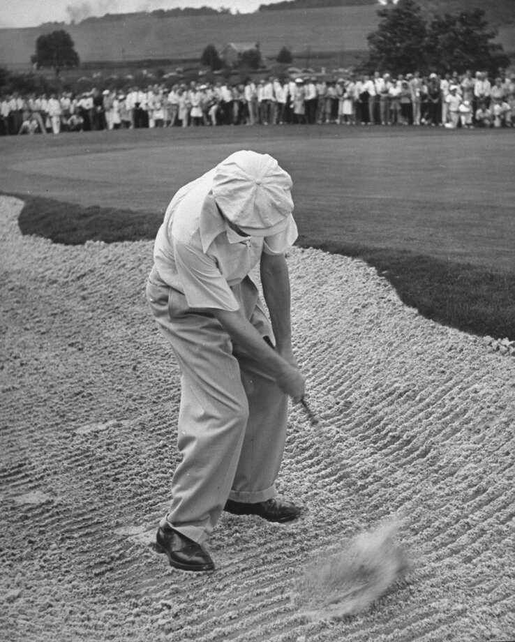 Golfer Byron Nelson, putting the ball out of the rough during the PGA tournament.  (Photo by Ralph Morse/Pix Inc./Time Life Pictures/Getty Images)