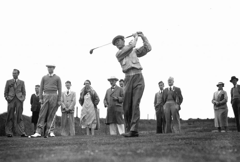 24th June 1937: US golfer Byron Nelson competing in a Ryder Cup match at Royal Birkdale, Southport. Teammate Densmore 'Denny' Shute stands on the left, holding a club. (Photo by Fox Photos/Getty Images)