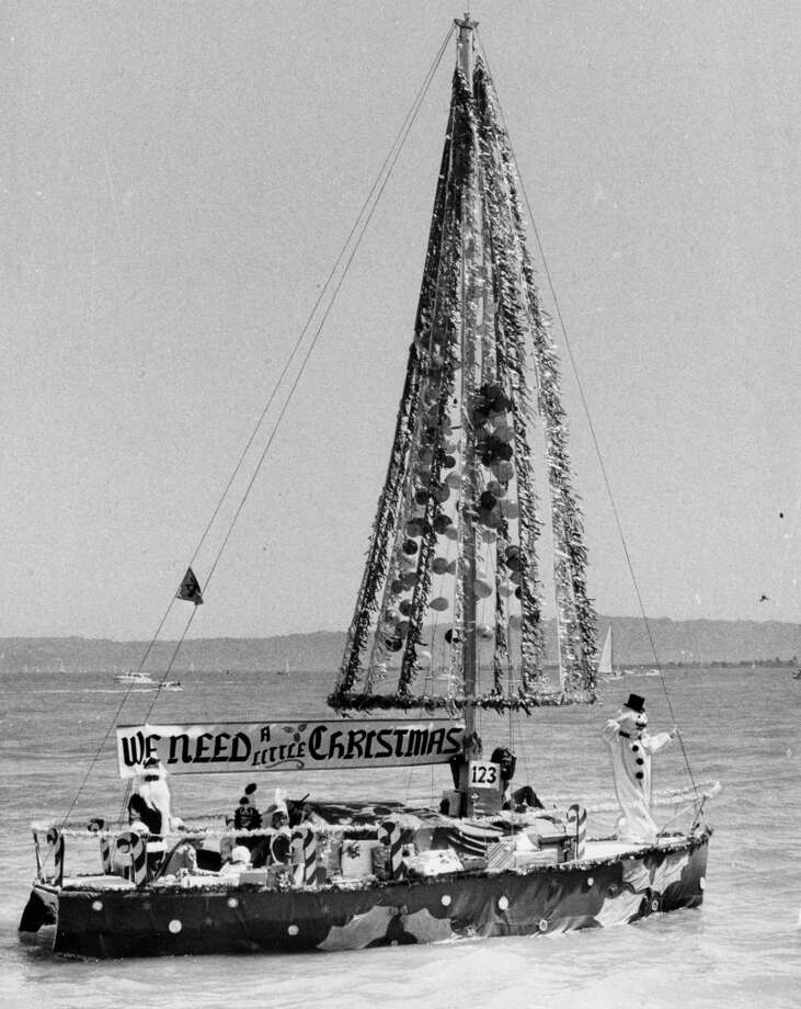 "Since the beginning of the last century,  ""Opening Day On The Bay"" has marked the start of the summer and boating season. But that didn't stop this sailor from turning his sail mast into a Christmas tree."