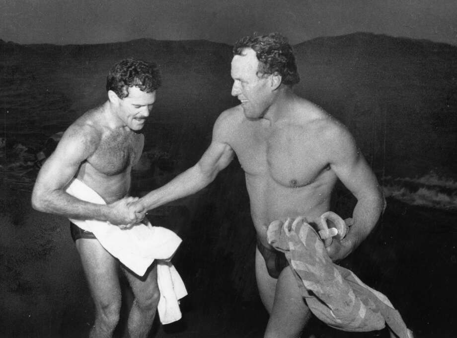 Alcatraz to Ft. Point Swim. Randy Williams and Dave Horning congratulate each other at Ft. Point following the swim. December 12, 1984.