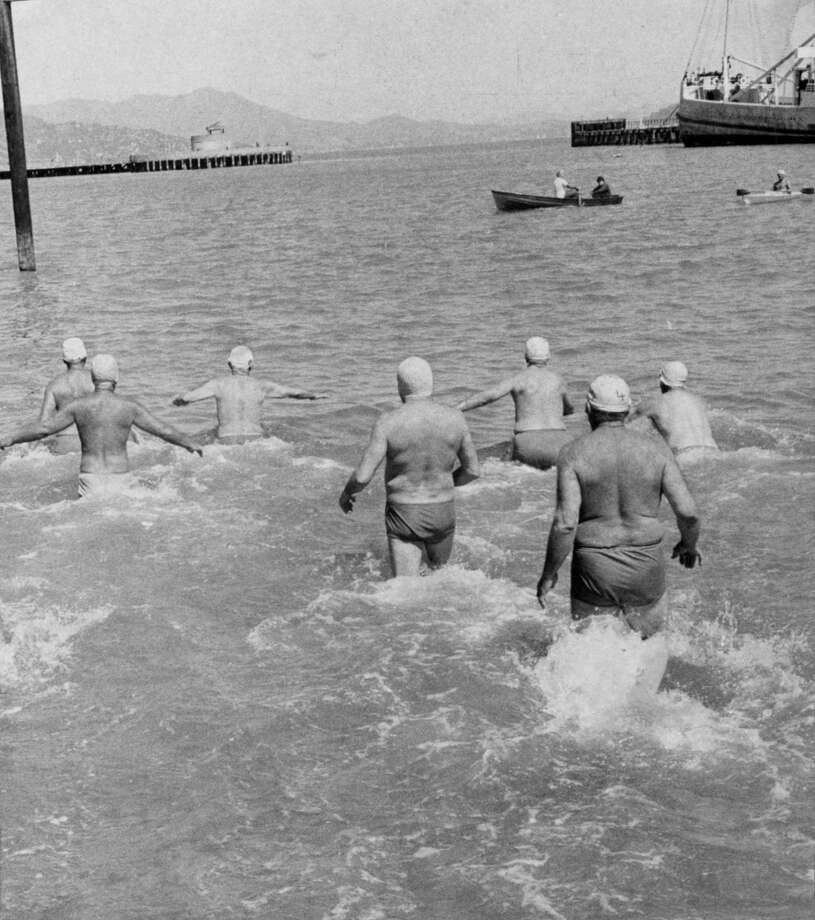 Men head out for a swim, May 20, 1974.