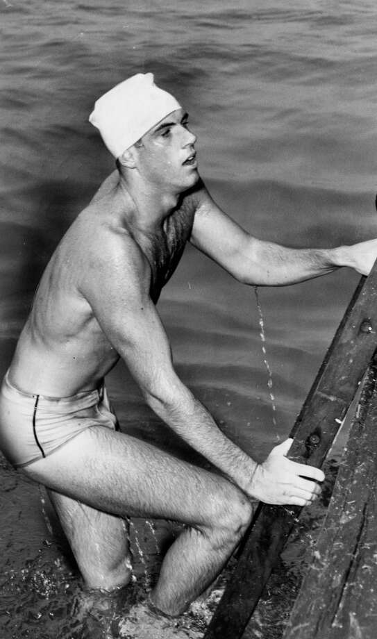 Winner Bill McIvor climbs into the pick-up boat at the annual Golden Gate Swim, September 20, 1953.