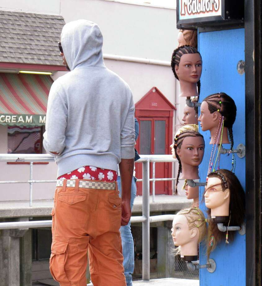 In a June 6, 2013 photo, a young man wears saggy pants on the Wildwood, N.J. boardwalk. Wildwood is set to pass a law Wednesday, June 12, 2013 regulating how people dress on its boardwalk, including a prohibition on pants that sag more than 3 inches below the hips, exposing either skin or underwear. Mayor Ernest Troiano said Wildwood has been inundated with complaints from tourists upon whose money the popular beach town depends for its survival. Photo: AP