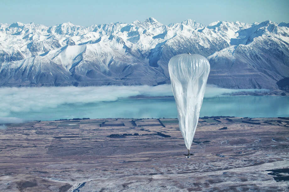 In this June 10, 2013 photo released by Jon Shenk, a Google balloon sails through the air with the Southern Alps mountains in the background, in Tekapo, New Zealand. Google is testing the balloons which sail in the stratosphere and beam the Internet to Earth. (AP Photo/Jon Shenk)  Photo: AP