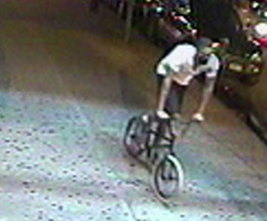 In this June 14, 2013, still image made from surveillance video provided by the New York City Police Department, a male suspect flees on a bicycle after allegedly firing several shots on a street in the Bronx borough of New York. One stray round struck a 9-year-old girl in the torso, sending her to the hospital. The male, believed to be in his mid to late teens, is still at large. Photo: AP