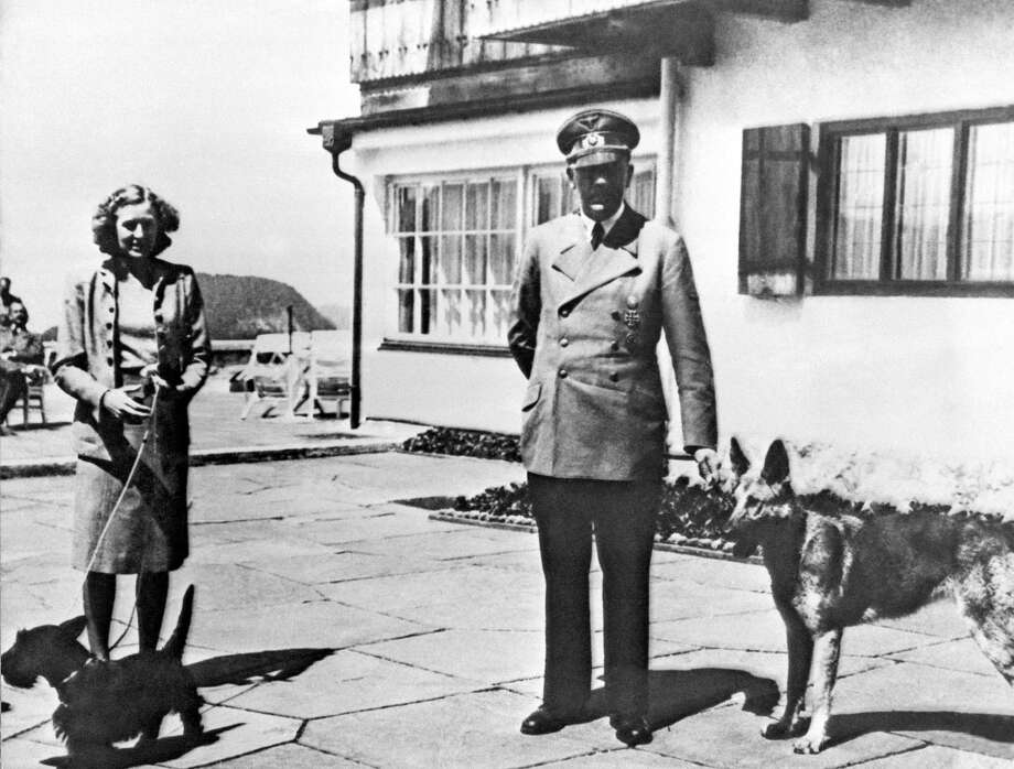 In this undated photo of Adolf Hitler and his mistress Eva Braun are posing on the Terrace of the Berghof, Berchtesgaden, Germany. Hitler's mountain retreat in Bavaria is getting a makeover, with a 17-million euro (US dollar 22.5 million) renovation project that will more-than double the historical documentation and information center now there. Munich's Sueddeutsche Zeitung reported Tuesday, June 11, 2013, the current 1,000 square meter (11,000 square foot) center will be expanded to 2,500 square meters (27,000 square feet) in a project that will take until 2018 to complete. Photo: AP