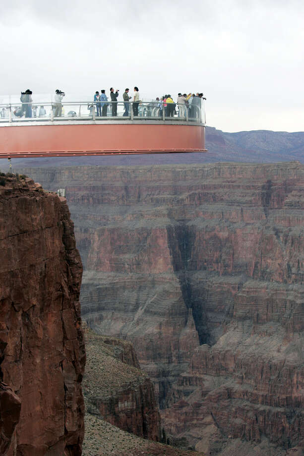 This March 20, 2007 file photo shows people walking on the Skywalk during the First Walk event at the Grand Canyon on the Hualapai Indian Reservation at Grand Canyon West, Ariz. David Jin the Chinese tour operator and Las Vegas businessman and who built this Grand Canyon Skywalk attraction in northwestern Arizona has died in Los Angeles. A Grand Canyon Skywalk Development spokesman said that Jin died Thursday June 13, 2013 at UCLA Medical Center after a four-year battle with cancer. He was 51. Photo: AP