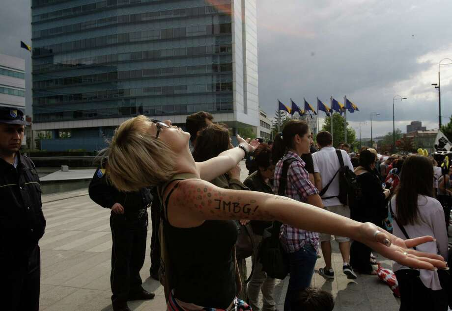 "Bosnian people demonstrate in front of Bosnian parliament building, in Sarajevo, on Tuesday, June 11, 2013. Bosnia's ""baby revolution"" began last week as a small protest of parents pushing strollers to parliament to demand politicians pass a new law allowing their newborns to get national identity numbers, and now, the anti-government demonstrations appear to be transcending ethnic boundaries and creating a sense of harmony between protesters. Photo: AP"