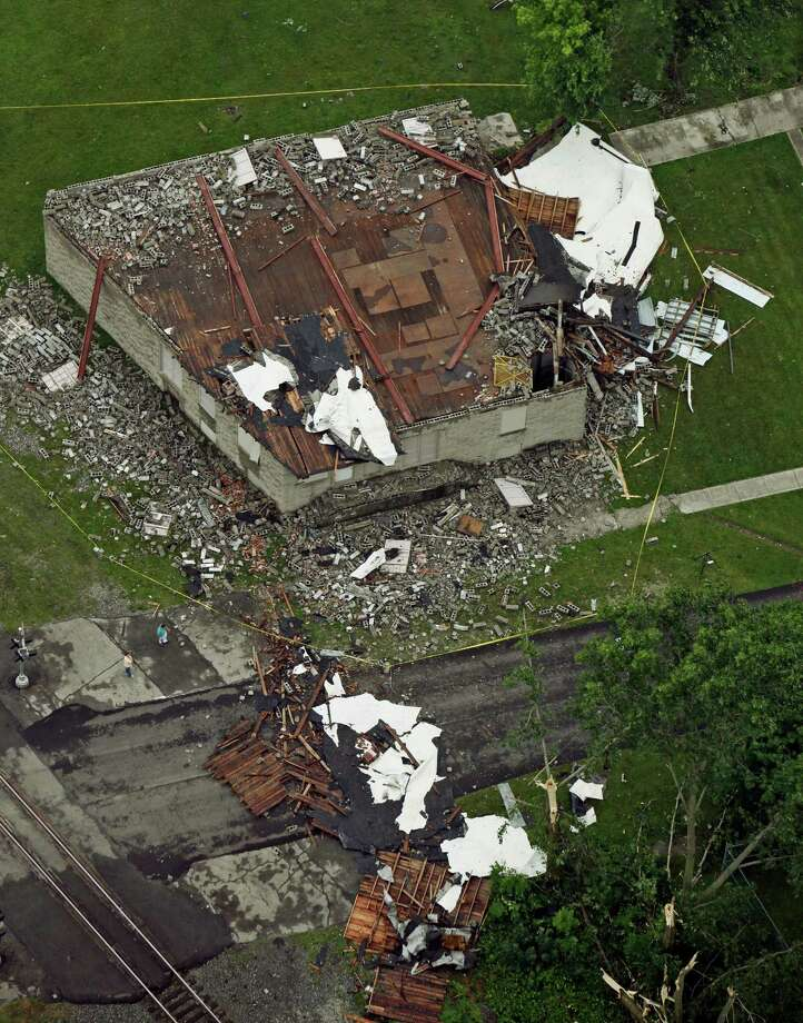 This aerial photo shows storm damaged buildings in Caledonia, Ohio in Marion County on Thursday,  June 13, 2013.  Storms with swift, straight-line winds soaked parts of Ohio, damaging trees and barns and leaving tens of thousands of customers without power Thursday as commuters dodged fallen branches on roads and backups at intersections where traffic lights were out. Photo: AP