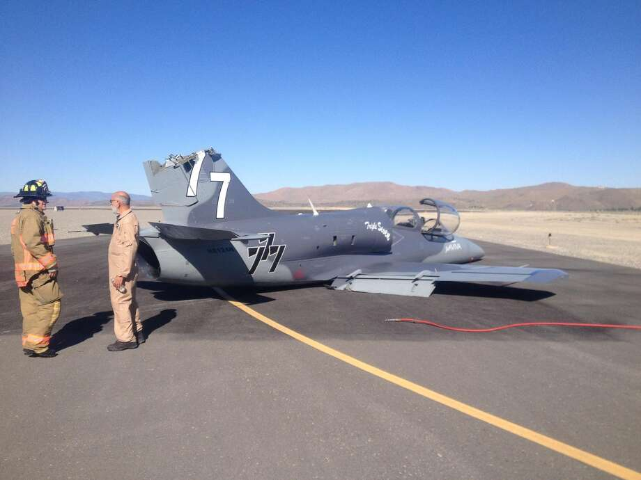 This June 13, 2013 photo provided by the Reno Fire Department shows a Czech-built military training jet sitting on the runway at Reno Stead Airport after it collided with another plane and suffered tail damage. The pilot was forced to make a belly landing during safety training for the 50th National Reno Air Races in Reno, Nev. Neither pilot was injured. The airport 20 miles north of Reno is the site where a pilot and 10 people on the ground were killed in a crash in September 2011. Photo: AP
