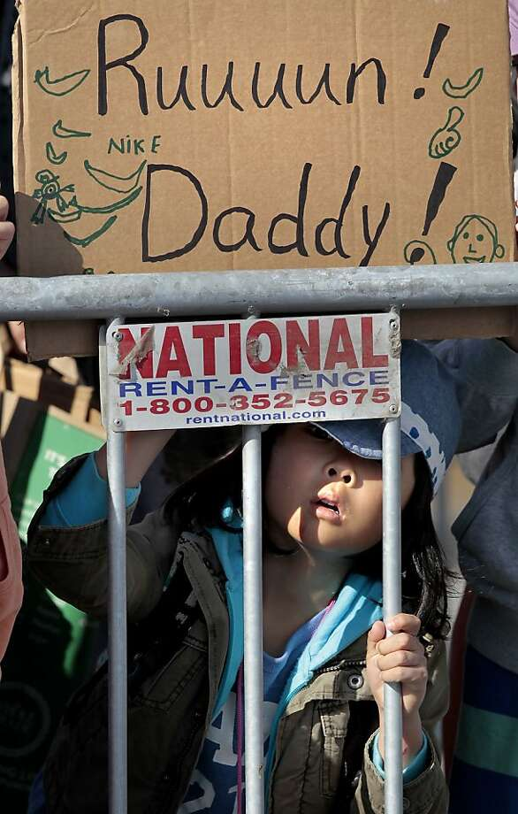 Little Ryotaro Ebisawa waited for her father to finish the marathon Sunday June 16, 2013. Thousands ran in the annual San Francisco Marathon, which was held earlier this year to accommodate the America's Cup races. Photo: Brant Ward, The Chronicle