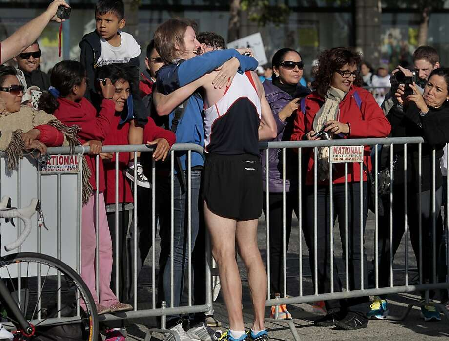 Marathon winner Francois Lhuissier got a hug from his girl friend Lucile Couronne at the finish line Sunday June 16, 2013. Thousands ran in the annual San Francisco Marathon, which was held earlier this year to accommodate the America's Cup races. Photo: Brant Ward, The Chronicle