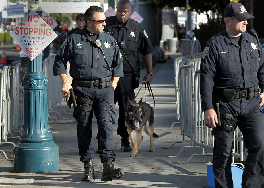 San Francisco police with dogs patrolled the finish line of the marathon Sunday June 16, 2013. Thousands ran in the annual San Francisco Marathon, which was held earlier this year to accommodate the America's Cup races. Photo: Brant Ward, The Chronicle