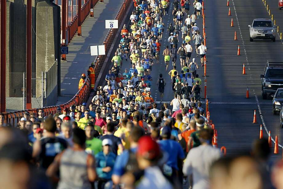 Marathon runners crowded onto the eastern side of the Golden Gate Bridge as part of the run Sunday June 16, 2013. Thousands ran in the annual San Francisco Marathon, which was held earlier this year to accommodate the America's Cup races. Photo: Brant Ward, The Chronicle