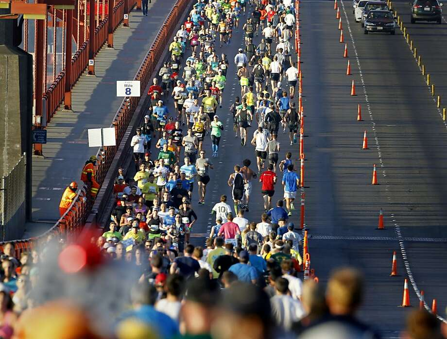 Marathon runners shared the eastern side of the Golden Gate Bridge as they completed this part of the marathon on a sunny morning Sunday June 16, 2013. Thousands ran in the annual San Francisco Marathon, which was held earlier this year to accommodate the America's Cup races. Photo: Brant Ward, The Chronicle