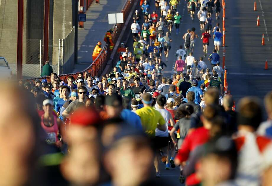 Marathon runners going north and south on the Golden Gate Bridge Sunday June 16, 2013. Thousands ran in the annual San Francisco Marathon, which was held earlier this year to accommodate the America's Cup races. Photo: Brant Ward, The Chronicle