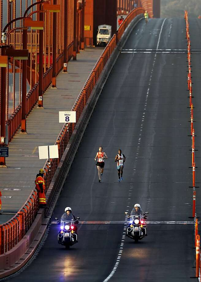 At mile eight, eventual marathon winner Francois Lhuissier (left) and second place finisher Ismail Ssenyange had the Golden Gate Bridge to themselves Sunday June 16, 2013. Thousands ran in the annual San Francisco Marathon, which was held earlier this year to accommodate the America's Cup races. Photo: Brant Ward, The Chronicle