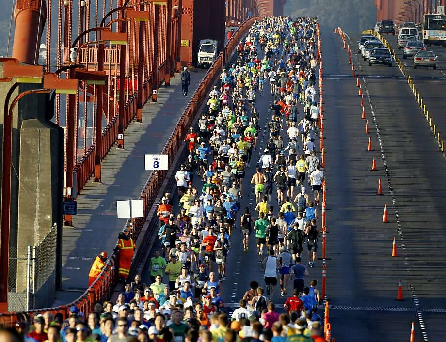 Marathon runners took up the eastern side of the bridge as they enjoyed a sunny sunrise Sunday June 16, 2013. Thousands ran in the annual San Francisco Marathon, which was held earlier this year to accommodate the America's Cup races. Photo: Brant Ward, The Chronicle