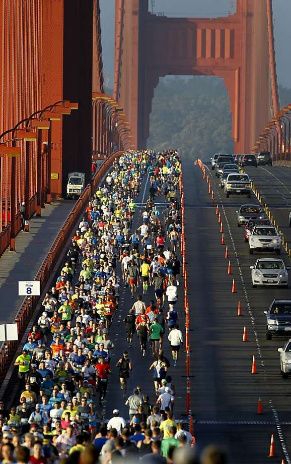 Runners took over the eastern side of the Golden Gate Bridge Sunday June 16, 2013. Thousands ran in the annual San Francisco Marathon, which was held earlier this year to accommodate the America's Cup races. Photo: Brant Ward, The Chronicle