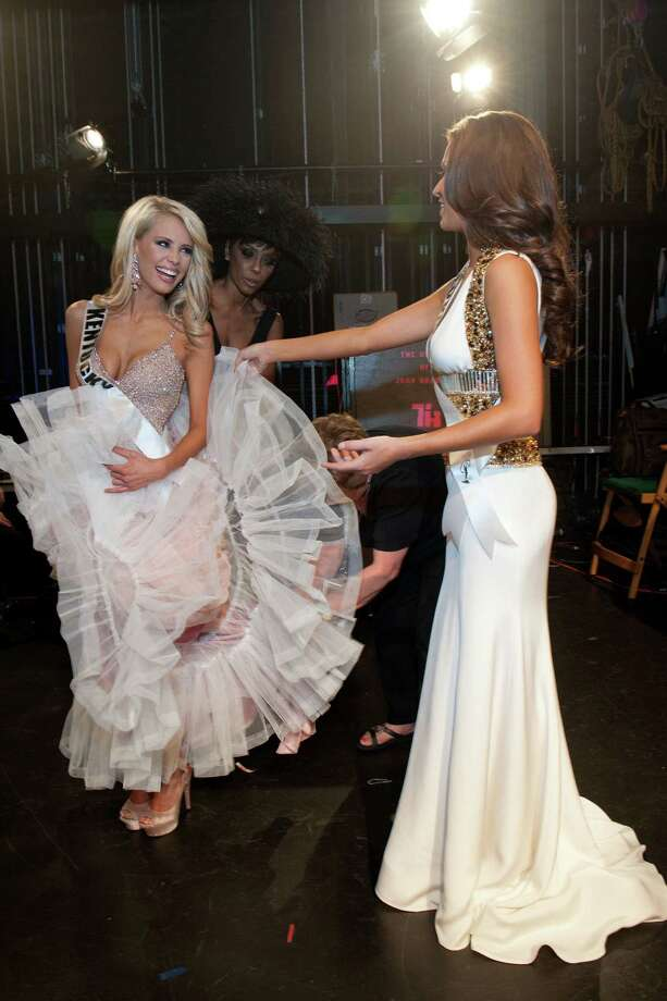 This photo provided by the Miss Universe Organization,  Miss Kentucky USA 2013, Allie Leggett; and Miss Missouri USA 2013, Ellie Holtman;  get ready to go on stage prior to the 2013 Miss USA Competition Preliminary Show  in Las Vegas  on Wednesday June 12, 2013.  She will compete for the title of Miss USA 2013 and the coveted Miss USA Diamond Nexus Crown on June 16, 2013. Photo: AP