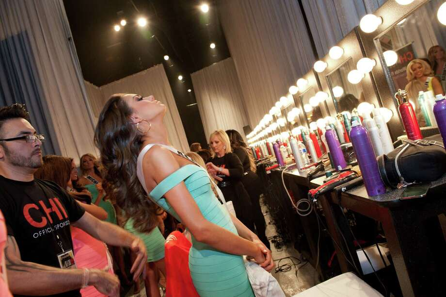 This photo provided by the Miss Universe Organization,  Miss Alabama USA 2013, Mary Margaret McCord has her hair styled prior to the 2013 Miss USA Competition Preliminary Show  in Las Vegas  on Wednesday June 12, 2013.  She will compete for the title of Miss USA 2013 and the coveted Miss USA Diamond Nexus Crown on June 16, 2013. Photo: AP