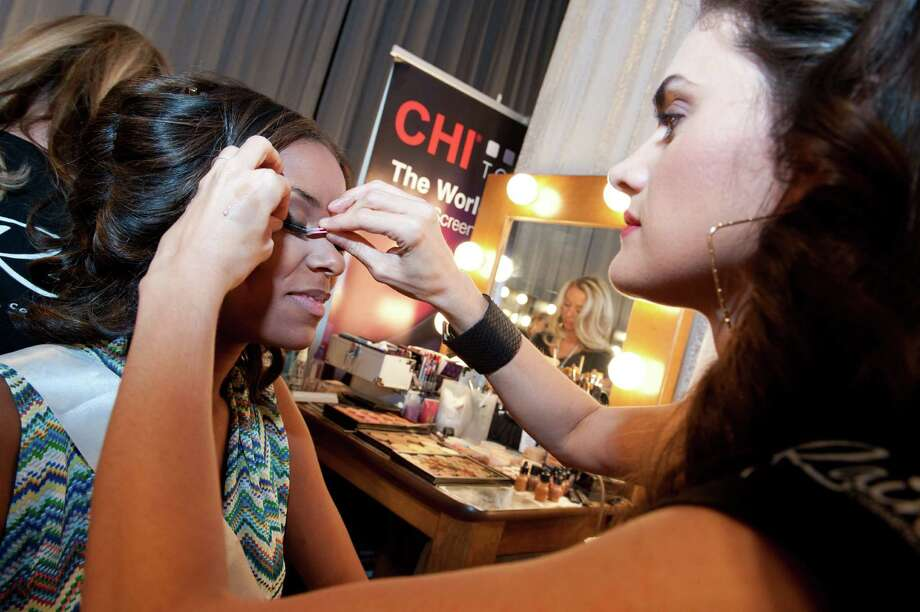This photo provided by the Miss Universe Organization,  Miss South Carolina USA 2013, Megan Pinckney gets her make up prepared  prior to the 2013 Miss USA Competition Preliminary Show  in Las Vegas  on Wednesday June 12, 2013.  She will compete for the title of Miss USA 2013 and the coveted Miss USA Diamond Nexus Crown on June 16, 2013. Photo: AP