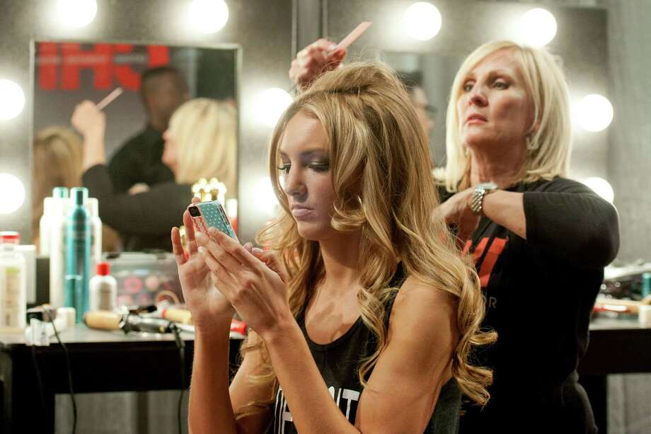 Miss Michigan USA 2013, Jaclyn Schultz has her hair styled prior to the 2013 Miss USA Competition Preliminary Show  in Las Vegas  on Wednesday June 12, 2013.  She will compete for the title of Miss USA 2013 and the coveted Miss USA Diamond Nexus Crown on June 16, 2013. Photo: AP