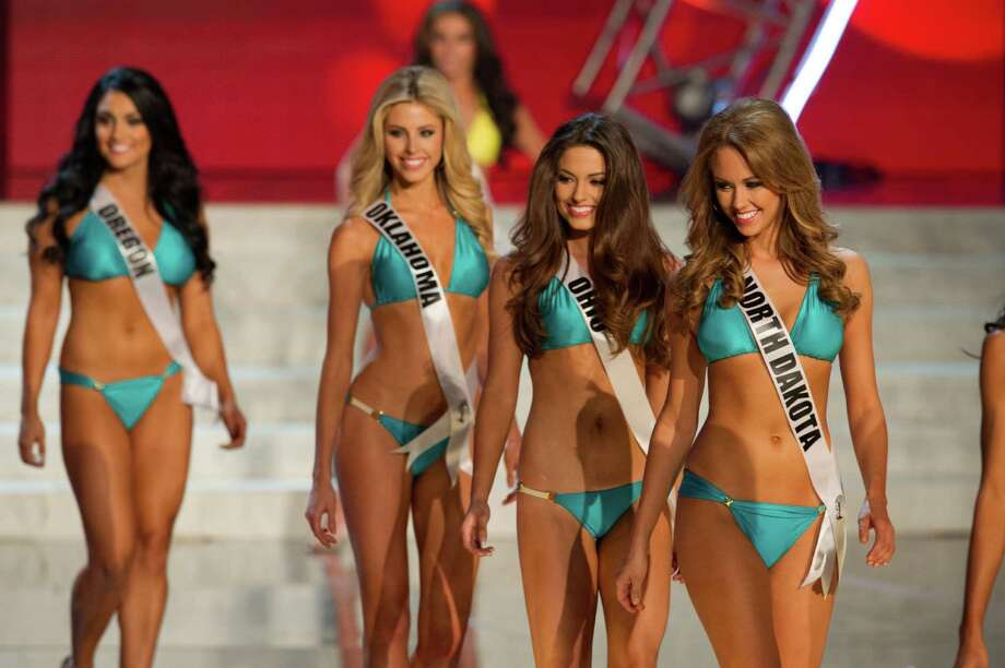 In this photo provided by the Miss Universe Organization,  Miss North Dakota USA 2013, Stephanie Erickson; Miss Ohio USA 2013, Kristin Smith; Miss Oklahoma USA 2013, Makenzie Muse; and Miss Oregon USA 2013, Gabrielle Neilan; compete in their swimsuits during the  2013 Miss USA Competition Preliminary Show in Las Vegas on Wednesday June 12, 2013.   She will compete for the title of Miss USA 2013 and the coveted Miss USA Diamond Nexus Crown on June 16, 2013. Photo: AP