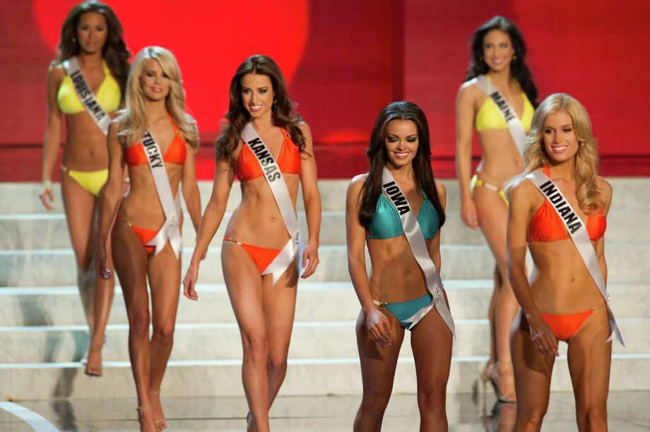 In this photo provided by the Miss Universe Organization,  Miss Indiana USA 2013, Emily Hart; Miss Iowa USA 2013, Richelle Orr; Miss Kansas USA 2013, Staci Klinginsmith; Miss Kentucky USA 2013, Allie Leggett; and Miss Louisiana USA 2013, Kristen Girault;  compete in their swimsuits during the  2013 Miss USA Competition Preliminary Show in Las Vegas on Wednesday June 12, 2013.   She will compete for the title of Miss USA 2013 and the coveted Miss USA Diamond Nexus Crown on June 16, 2013. Photo: AP