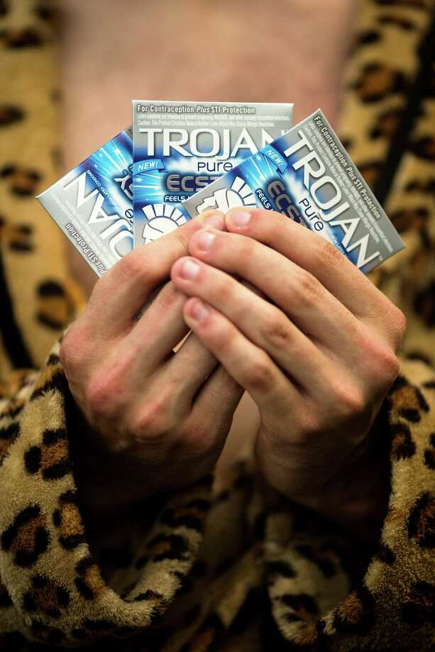 Zach Miller fans out a selection of Trojan condoms from the pocket of his bathrobe at Warped Tour on Saturday, June 15, 2013, at the White River Amphitheatre in Auburn. Fans with unique styles showed off the contents of their pockets or the item on their person that meant the most to them. Photo: JORDAN STEAD, SEATTLEPI.COM / SEATTLEPI.COM