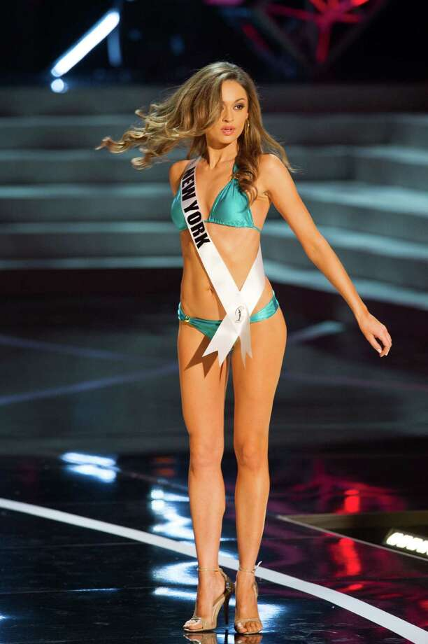 In this photo provided by the Miss Universe Organization,  Miss New York USA 2013, Joanne Nosuchinsky,  competes in her swimsuit during the  2013 Miss USA Competition Preliminary Show in Las Vegas on Wednesday June 12, 2013.   She will compete for the title of Miss USA 2013 and the coveted Miss USA Diamond Nexus Crown on June 16, 2013. Photo: AP