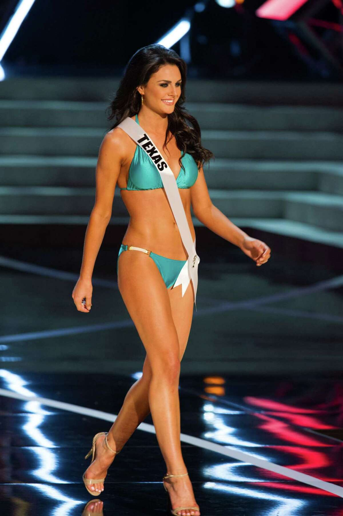 In this photo provided by the Miss Universe Organization, Miss Texas USA 2013, Ali Nugent, competes in her swimsuit during the 2013 Miss USA Competition Preliminary Show in Las Vegas on Wednesday June 12, 2013. She will compete for the title of Miss USA 2013 and the coveted Miss USA Diamond Nexus Crown on June 16, 2013.