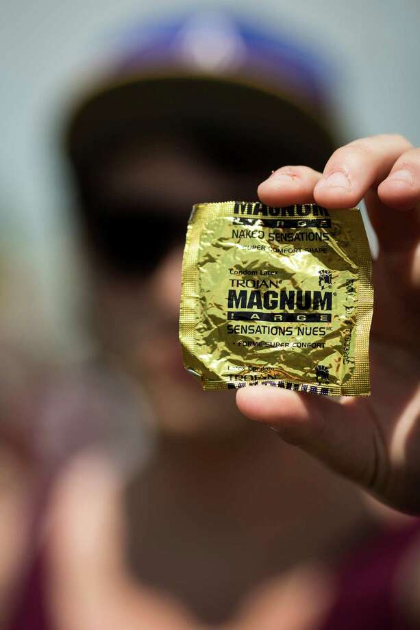Colby Weeds fishes a Magnum condom out of his pocket at Warped Tour on Saturday, June 15, 2013, at the White River Amphitheatre in Auburn. Fans with unique styles showed off the contents of their pockets or the item on their person that meant the most to them. Photo: JORDAN STEAD, SEATTLEPI.COM / SEATTLEPI.COM