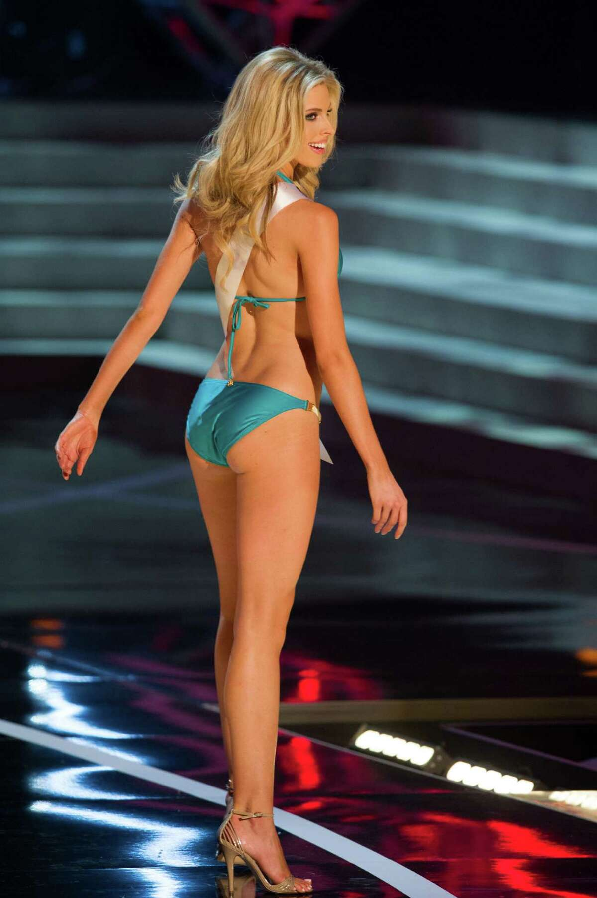 In this photo provided by the Miss Universe Organization, Miss Oklahoma USA 2013, Makenzie Muse, competes in her swimsuit during the 2013 Miss USA Competition Preliminary Show in Las Vegas on Wednesday June 12, 2013. She will compete for the title of Miss USA 2013 and the coveted Miss USA Diamond Nexus Crown on June 16, 2013.