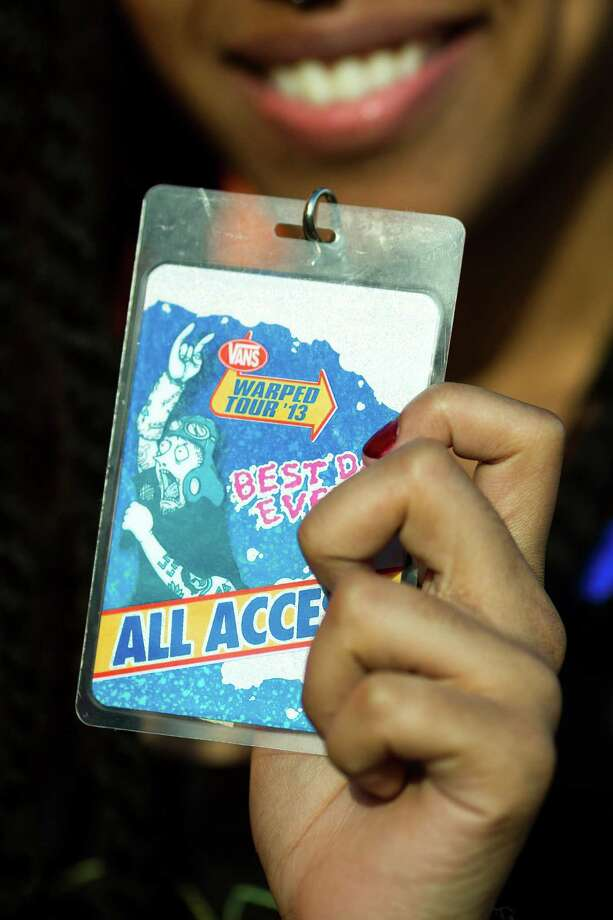 Jasmine Florencio presents her all access pass to Warped Tour on Saturday, June 15, 2013, at the White River Amphitheatre in Auburn. Fans with unique styles showed off the contents of their pockets or the item on their person that meant the most to them. Photo: JORDAN STEAD, SEATTLEPI.COM / SEATTLEPI.COM