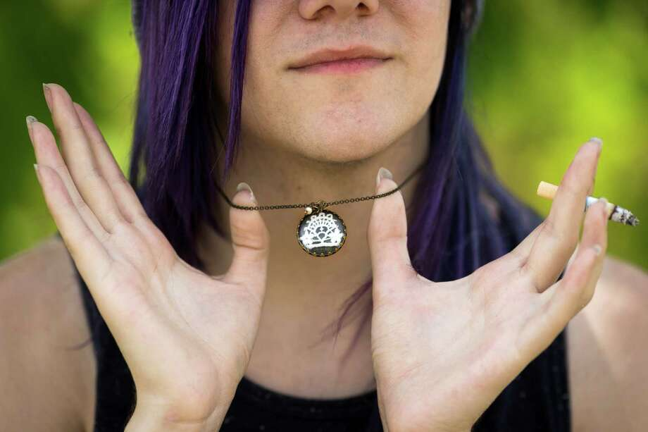 Griffin DeJaco presents his favorite piece of jewelry, a necklace, during Warped Tour on Saturday, June 15, 2013, at the White River Amphitheatre in Auburn. Fans with unique styles showed off the contents of their pockets or the item on their person that meant the most to them. Photo: JORDAN STEAD, SEATTLEPI.COM / SEATTLEPI.COM