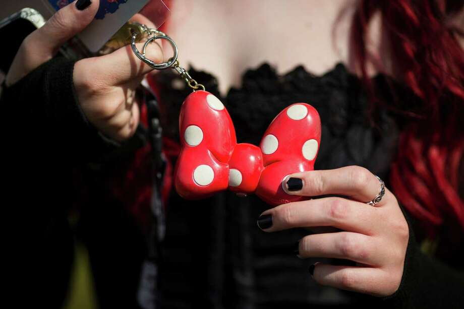 Samm Stewart presents her polka dotted keychain at Warped Tour on Saturday, June 15, 2013, at the White River Amphitheatre in Auburn. Fans with unique styles showed off the contents of their pockets or the item on their person that meant the most to them. Photo: JORDAN STEAD, SEATTLEPI.COM / SEATTLEPI.COM