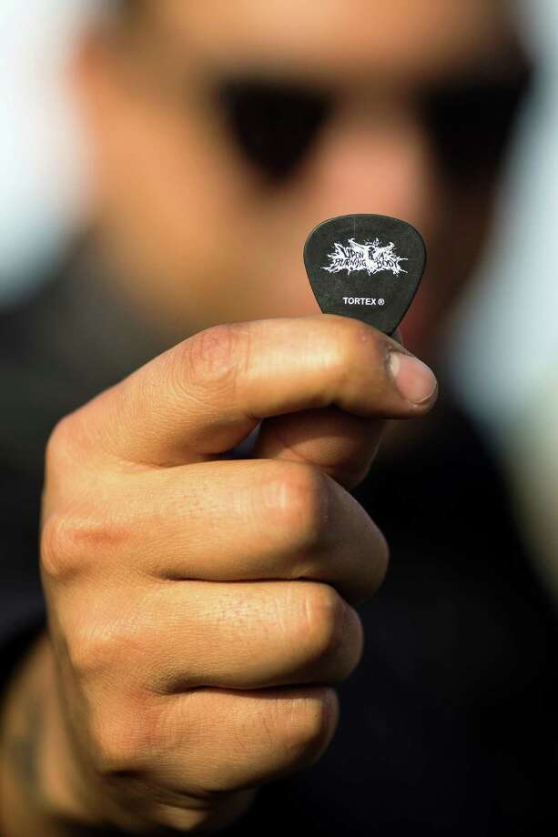 Ruben Alvarez, guitarist for the deathcore band Upon A Burning Body, draws a guitar pick out his pocket at Warped Tour on Saturday, June 15, 2013, at the White River Amphitheatre in Auburn. Fans with unique styles showed off the contents of their pockets or the item on their person that meant the most to them. Photo: JORDAN STEAD, SEATTLEPI.COM / SEATTLEPI.COM
