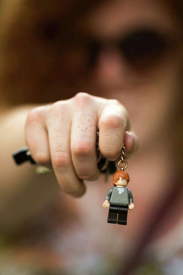 Keegan Prosser shows off her Lego figurine attached to her keys at Warped Tour on Saturday, June 15, 2013, at the White River Amphitheatre in Auburn. Fans with unique styles showed off the contents of their pockets or the item on their person that meant the most to them. Photo: JORDAN STEAD, SEATTLEPI.COM / SEATTLEPI.COM