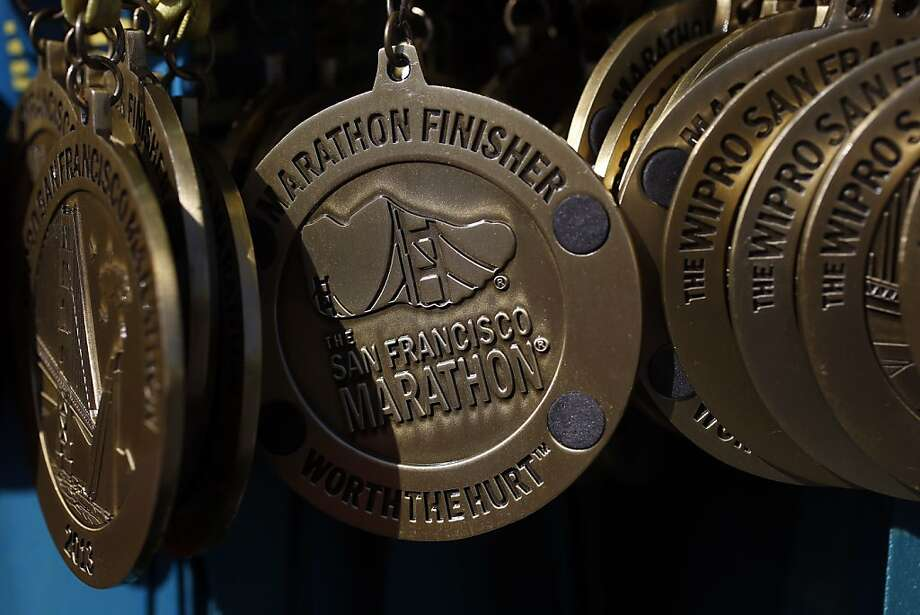 Finisher medals hang on a cart at the finish line of the 2013 Wipro San Francisco Marathon in San Francisco, Calif. on June 16, 2013. Photo: Ian C. Bates, The Chronicle