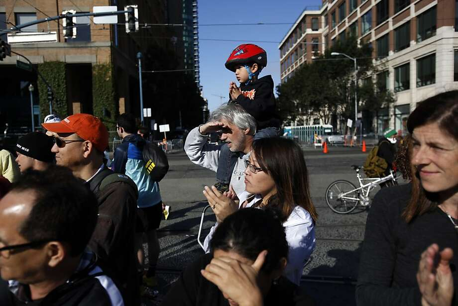Spectators watch as runners cross the finish line at the 2013 Wipro San Francisco Marathon in San Francisco, Calif. on June 16, 2013. Photo: Ian C. Bates, The Chronicle