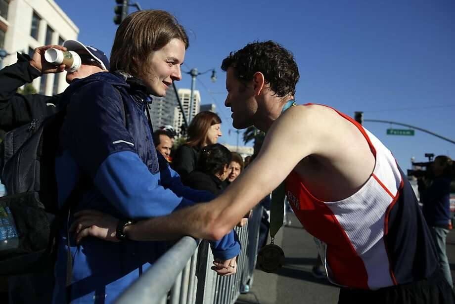 Overall first place winner Francois Lhuissier, right, talks with his girlfriend Lucile Couronne, left, after winning the 2013 Wipro San Francisco Marathon in San Francisco, Calif. on June 16, 2013. Photo: Ian C. Bates, The Chronicle