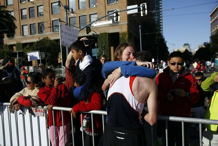 Overall first place winner Francois Lhuissier is hugged by his girlfriend Lucile Couronne after winning the 2013 Wipro San Francisco Marathon in San Francisco, Calif. on June 16, 2013. Photo: Ian C. Bates, The Chronicle