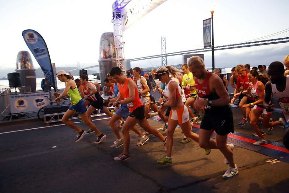 The elite runners start the marathon during the 2013 Wipro San Francisco Marathon in San Francisco, Calif. on June 16, 2013. Photo: Ian C. Bates, The Chronicle