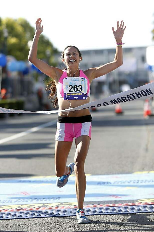 Women's first place winner Anna Bretan of Berkeley crosses the finish line during the 2013 Wipro San Francisco Marathon in San Francisco, Calif. on June 16, 2013. It was Bretan's second time running in the San Francisco Marathon. Photo: Ian C. Bates, The Chronicle
