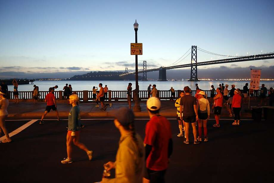 Marathon runners warm up along the Embarcadero before the start of the 2013 Wipro San Francisco Marathon in San Francisco, Calif. on June 16, 2013. Photo: Ian C. Bates, The Chronicle