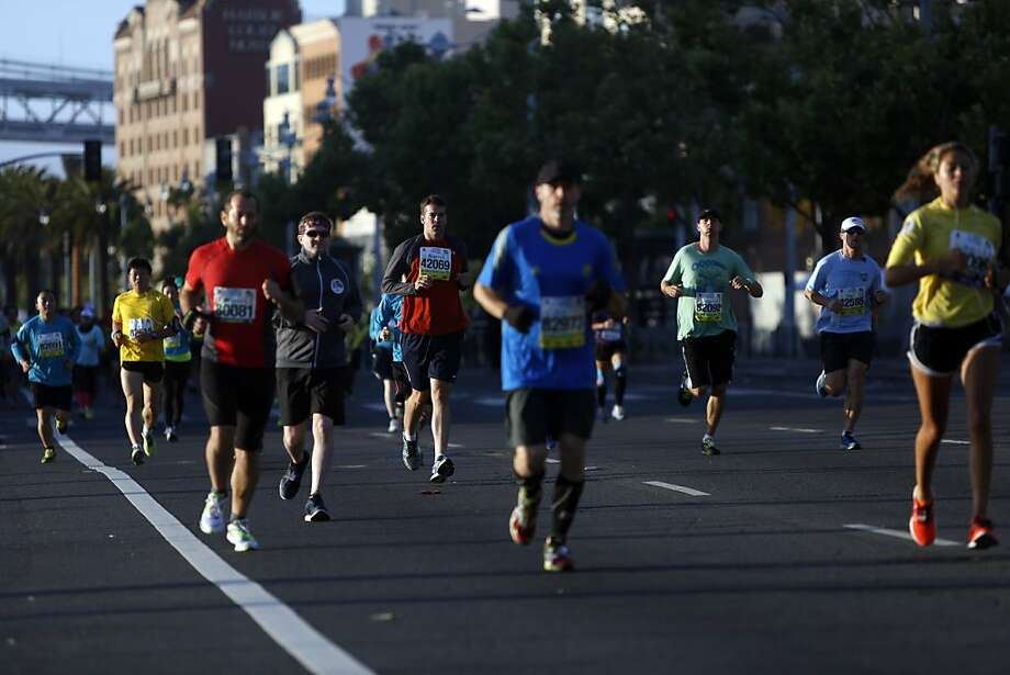 Marathon runners run through the Embarcadero during the 2013 Wipro San Francisco Marathon in San Francisco, Calif. on June 16, 2013. Photo: Ian C. Bates, The Chronicle