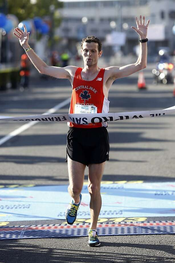 Overall first place winner Francois Lhuissier of Paris, France crosses the finish line during the 2013 Wipro San Francisco Marathon in San Francisco, Calif. on June 16, 2013. Photo: Ian C. Bates, The Chronicle